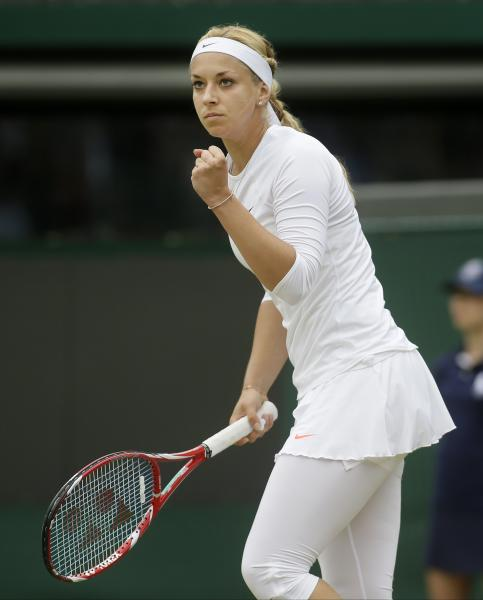 Sabine Lisicki of Germany reacts after scoring a point in a Women's singles quarterfinal match against Kaia Kanepi of Estonia at the All England Lawn Tennis Championships in Wimbledon, London, Tuesday, July 2, 2013. (AP Photo/Alastair Grant)