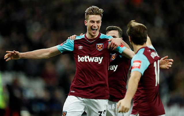 Soccer Football - FA Cup Third Round Replay - West Ham United vs Shrewsbury Town - London Stadium, London, Britain - January 16, 2018 West Ham United's Reece Burke celebrates scoring their first goal with team mates Action Images via Reuters/John Sibley