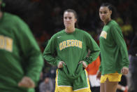 Oregon's Sabrina Ionescu, center, pauses while warming up during the first half of an NCAA college basketball game against Oregon State in Corvallis, Ore., Sunday, Jan. 26, 2020. (AP Photo/Amanda Loman)