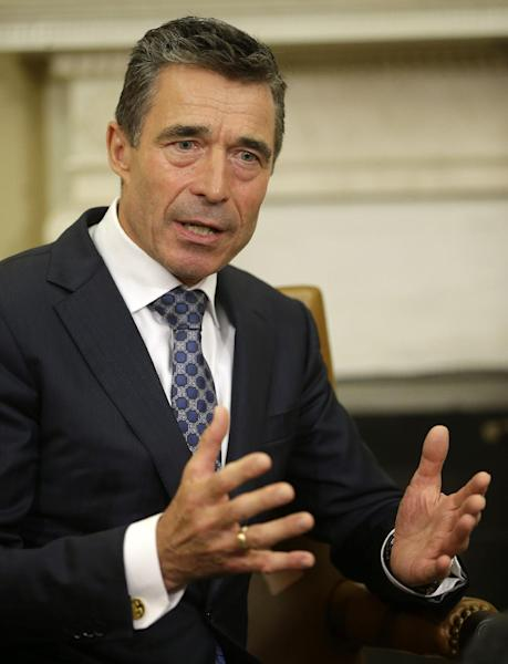 NATO Secretary General Anders Fogh Rasmussen gestures during his meeting with President Barack Obama in the Oval Office of the White House in Washington, Friday, May 31, 2013. (AP Photo/Pablo Martinez Monsivais)