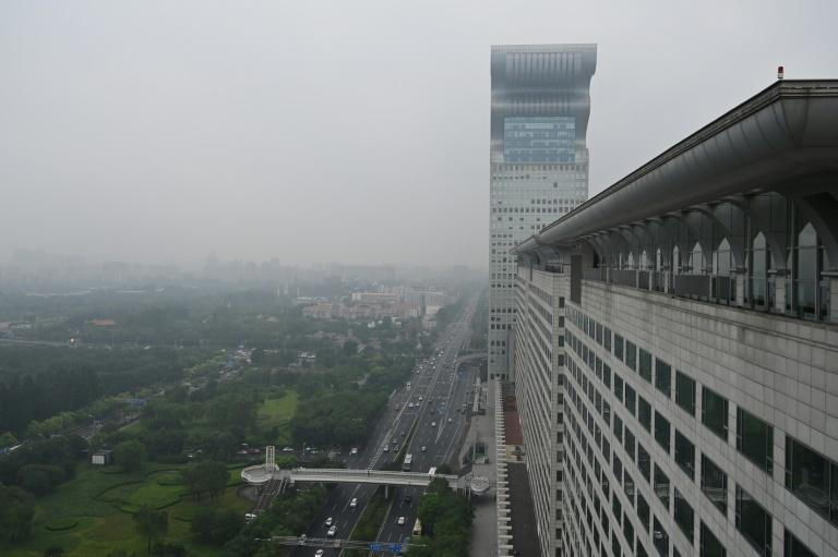 The building, shaped like a modernist dragon, was put on sale by creditors after being seized from billionaire Guo Wengui, who fled into exile after being accused of corruption in 2014
