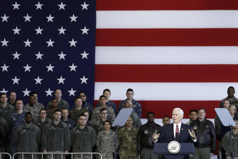 U.S. Vice President Mike Pence gestures as he addresses U.S. military personnel at U.S. Yokota Air Base, on the outskirts of Tokyo, Thursday, Feb. 8, 2018. (Kiyoshi Ota/Pool Photo via AP)