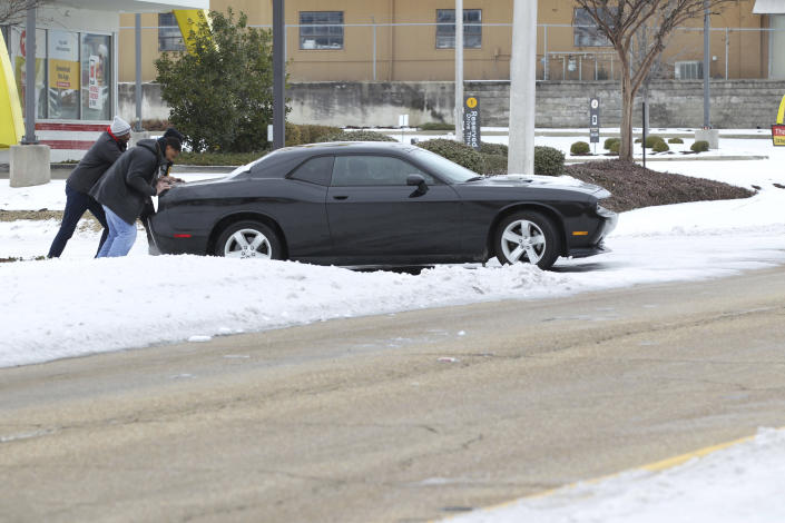 While many of the main roads in North Mississippi are open without much ice a vast majority of the side roads are still covered in layers of ice as this driver is affected Wednesday, Feb. 17, 2021, in Tupelo, Miss. (Thomas Wells/The Northeast Mississippi Daily Journal via AP)
