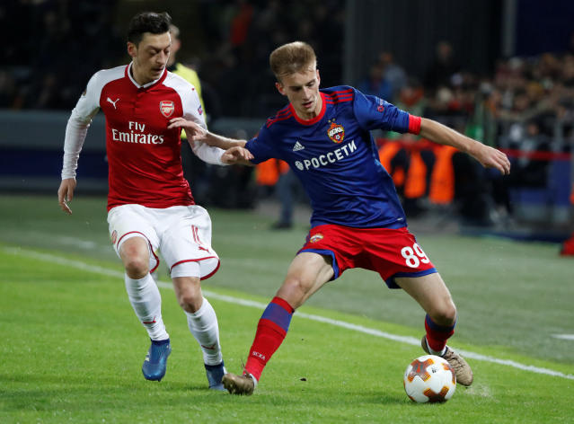Soccer Football - Europa League Quarter Final Second Leg - CSKA Moscow v Arsenal - VEB Arena, Moscow, Russia - April 12, 2018 CSKA Moscow's Konstantin Kuchaev in action with Arsenal's Mesut Ozil REUTERS/Grigory Dukor