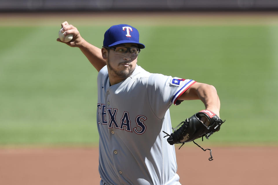 Texas Rangers pitcher Dane Dunning delivers to the Baltimore Orioles in the first inning of a baseball game Sunday, Sept. 26, 2021, in Baltimore. (AP Photo/Gail Burton)