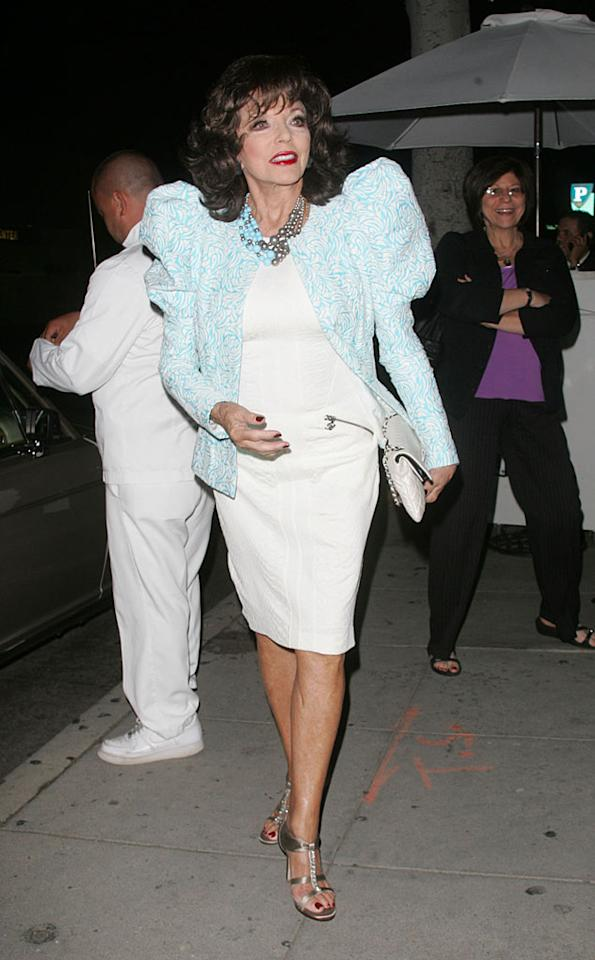 """The more we look at this pic of Joan Collins, the more we seem to like the former """"Dynasty"""" diva's fashion-forward ensemble. What do you think? Is this Lady Gaga-esque blazer a bit too much for the 77-year-old screen legend? <a href=""""http://www.infdaily.com"""" target=""""new"""">INFDaily.com</a> - November 3, 2010"""