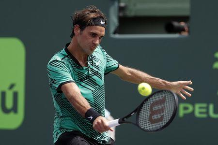 FILE PHOTO: Apr 2, 2017; Key Biscayne, FL, USA; Roger Federer of Switzerland hits a backhand against Rafael Nadal of Spain (not pictured) in the men's singles championship of the 2017 Miami Open at Crandon Park Tennis Center. Geoff Burke-USA TODAY Sports