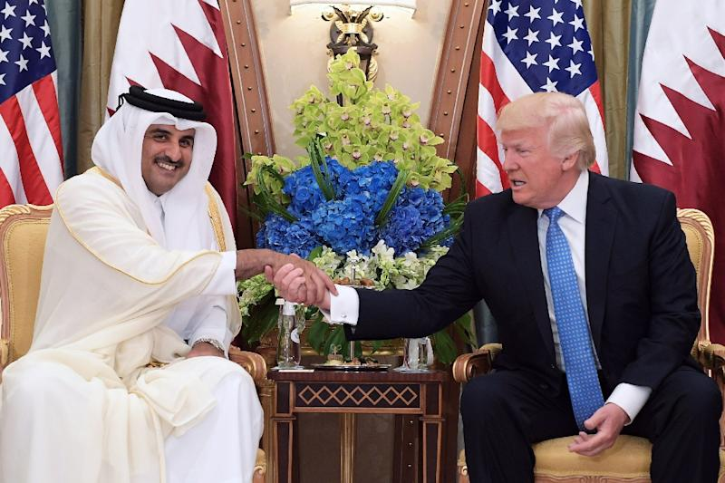"US President Trump, who had initially backed the measures against Qatar in a tweet, called Sheik Tamim (L) on Wednesday with an offer ""to help the parties resolve their differences"" (AFP Photo/Mandel NGAN)"