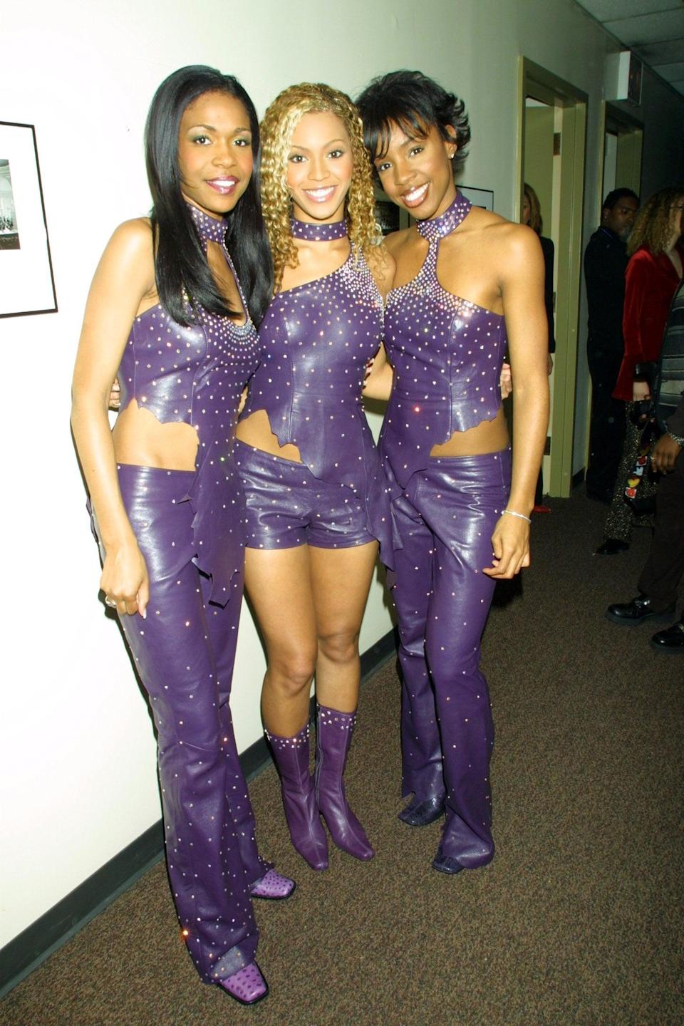 <p>Who knew purple and leather could look so good? Here they are at an event in 2001. </p>