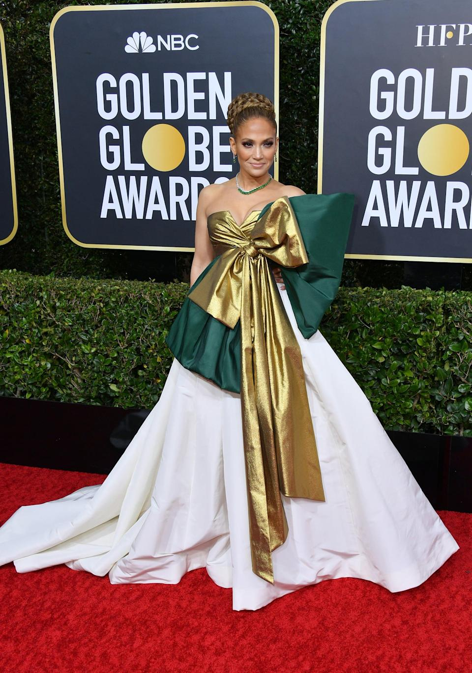 """<p><a href=""""https://www.popsugar.com/fashion/jennifer-lopez-dress-golden-globes-2020-47068542"""" class=""""link rapid-noclick-resp"""" rel=""""nofollow noopener"""" target=""""_blank"""" data-ylk=""""slk:Jennifer Lopez's double-bow Valentino gown"""">Jennifer Lopez's double-bow Valentino gown</a> reminded us of the presents underneath our Christmas tree at the 2020 Golden Globes. What's even more extraordinary? She was swathed in 145 carats of Henry Winston emeralds and diamonds!</p>"""