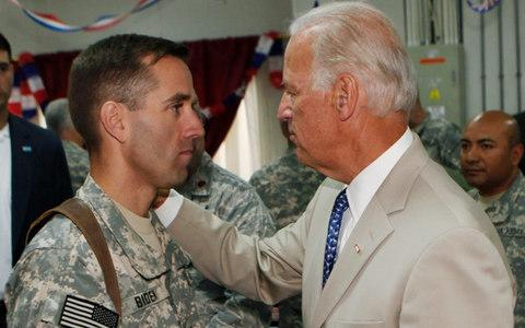 Joe Biden, right, talks with his son Beau Biden, who died in 2015 - Credit: AP Photo/Khalid Mohammed