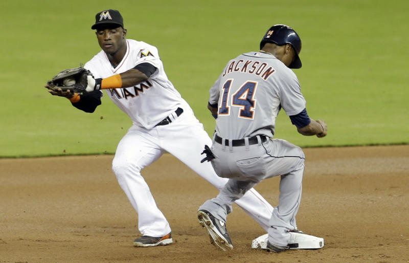 Detroit Tigers' Austin Jackson (14) is safe as he returns to second base as Miami Marlins' shortstop Adeiny Hechavarria, left, receives the late throw in the first inning of an interleague baseball game on Saturday, Sept. 28, 2013, in Miami. (AP Photo/Alan Diaz)