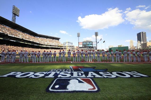 The St. Louis Cardinals line up on the first base line during the introductions for Game 3 of a National League division baseball series against the Pittsburgh Pirates on Sunday, Oct. 6, 2013 in Pittsburgh , PA (AP Photo/Gene J. Puskar)