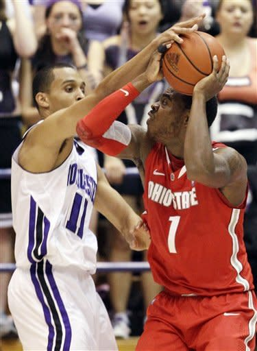 Ohio State forward Deshaun Thomas (1) looks to the basket as Northwestern guard Reggie Hearn (11) guards during the first half of an NCAA college basketball game in Evanston, Ill., Wednesday, Feb. 29, 2012. (AP Photo/Nam Y. Huh)