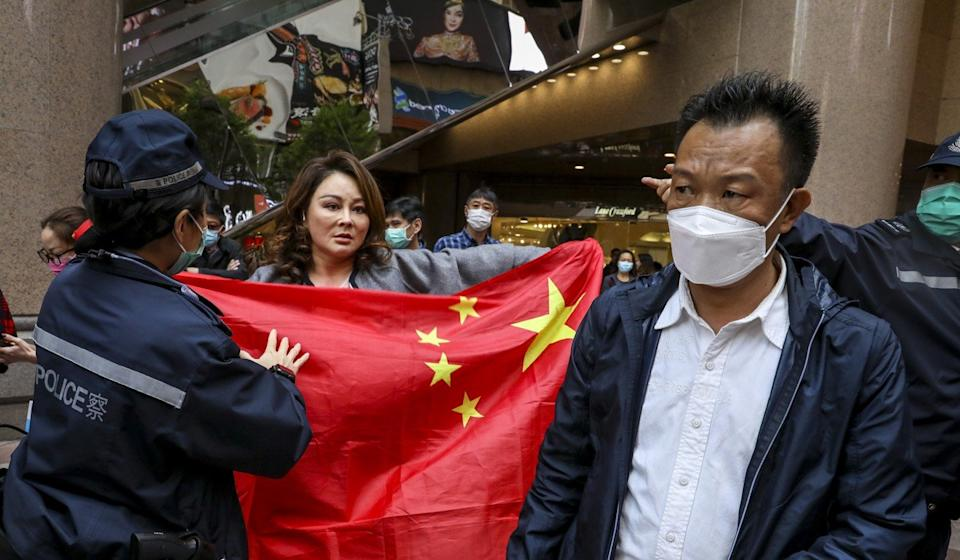 Pro-Beijing protesters rally opposite anti-government protesters during a lunchtime demonstration at Times Square in Causeway Bay. Photo: Dickson Lee