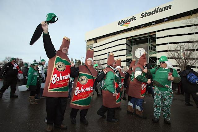 REGINA, SK - NOVEMBER 24: Fans gather outside of Mosaic Stadium prior to the start of the 101st Grey Cup Championship Game between the Hamilton Tiger-Cats and the Saskatchewan Roughriders on November 24, 2013 in Regina, Canada. (Photo by Jeff Gross/Getty Images)