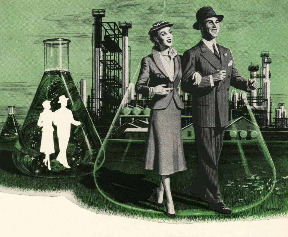 Vintage illustration of couples walking inside chemistry beakers in front of a chemical processing plant, 1952. Screen print. (Illustration by GraphicaArtis/Getty Images)
