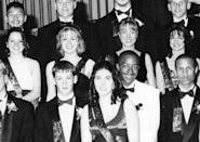 <p>Joel Madden, front left, wasn't always a tattooed rocker. This 1997 photo from his prom at La Plata High School in La Plata, Md., shows him wearing a suit while being honored as a member of his school's prom court. Still, don't be fooled, because he and twin brother, Benji, had already formed their famous band, Good Charlotte. <i>(Photo: Seth Poppel/Yearbook Library)</i></p>