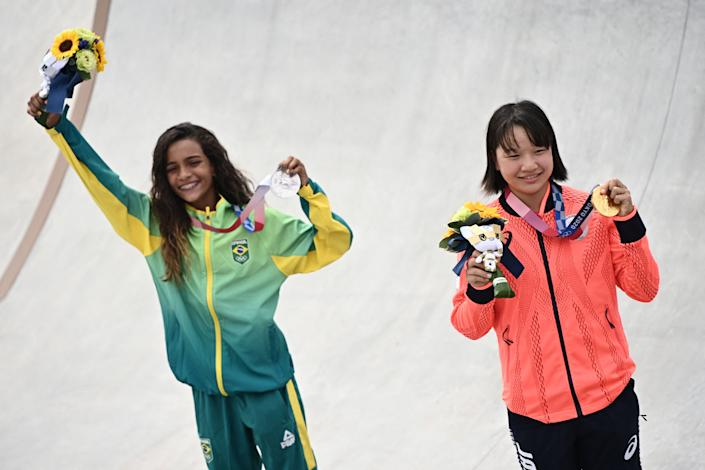 Japan's Momiji Nishiya (right) and Brazil's Rayssa Leal won gold and silver, respectively, in the women's street final of Olympic skateboarding on Monday. And they're a combined 26 years old. (Photo by LIONEL BONAVENTURE/AFP via Getty Images)