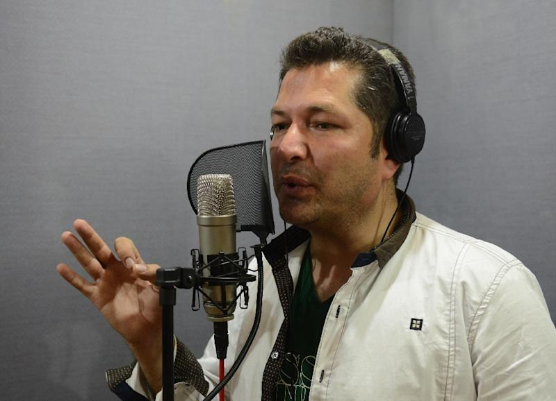 Popular Pashto singer Bakhtiar Khattak records a song at a studio in Peshawar (AFP Photo/A Majeed)