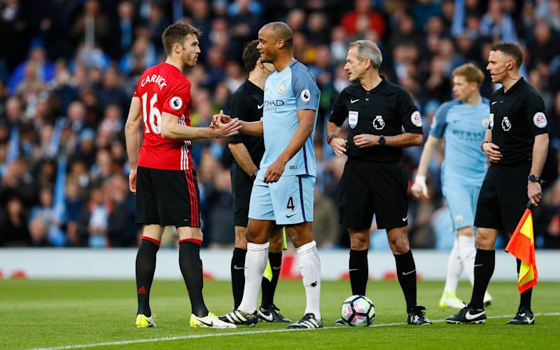 Manchester United%27s Michael Carrick and Manchester City - Credit: REUTERS