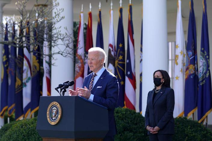 U.S. President Joe Biden speaks during an event on the American Rescue Plan as U.S. Vice President Kamala Harris listens in the Rose Garden of the White House on March 12, 2021 in Washington, DC.
