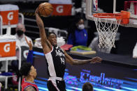Los Angeles Clippers guard Terance Mann, right, goes up for a dunk as Philadelphia 76ers forward Danny Green defends during the second half of an NBA basketball game Saturday, March 27, 2021, in Los Angeles. The Clippers won 122-112. (AP Photo/Mark J. Terrill)