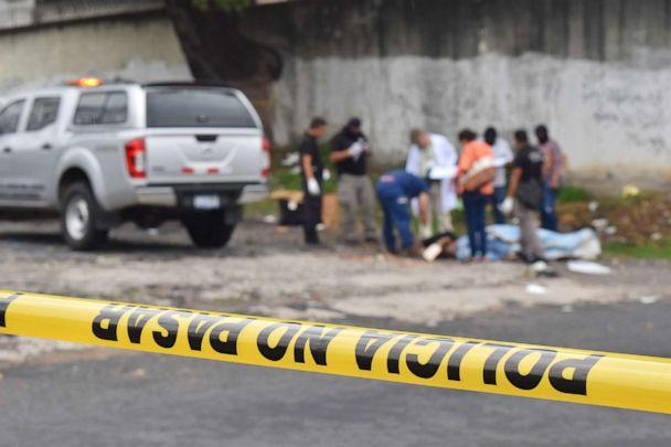 PHOTO: Salvadoran forensic police work at a crime scene, where a man was murdered, in San Salvador, May 29, 2019. (Oscar Rivera/AFP/Getty Images)
