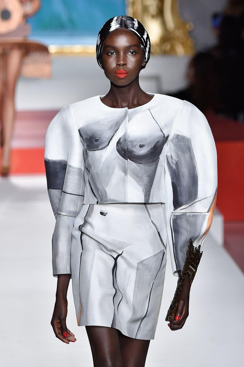 <p>Ajok Madel is new to the modeling world but has already made a name for herself by booking runway shows for Alexander McQueen, Tom Ford and Dries van Noten. She's South Sudanese, but grew up in Australia. </p>