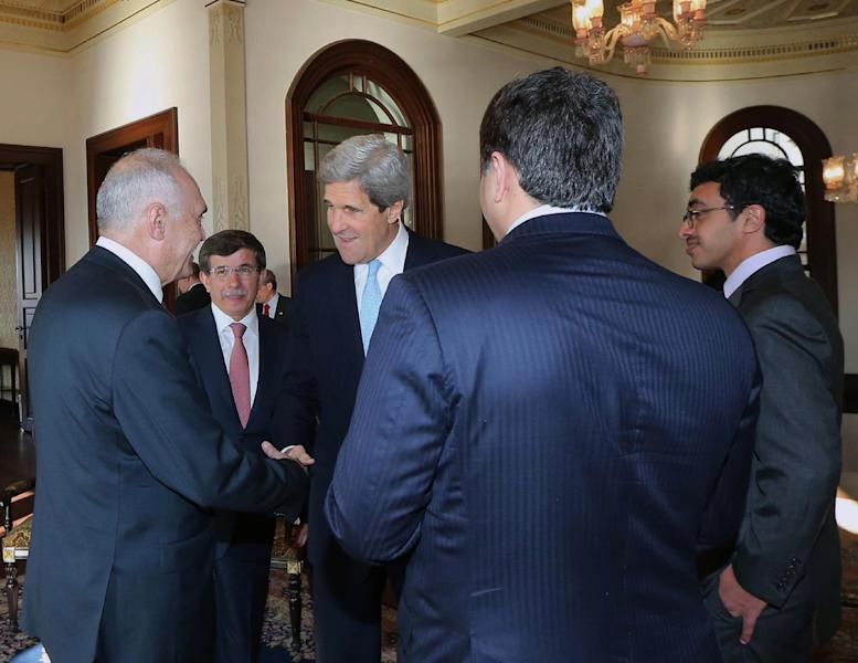 U.S. Secretary of State John Kerry, center, and members of the Friends of Syria group are seen during a meeting in Istanbul, Turkey, Saturday, April 20, 2013. Kerry is expected to announce a significant expansion of non-lethal aid to the Syrian opposition.(AP Photo/Hakan Goktepe, Pool)