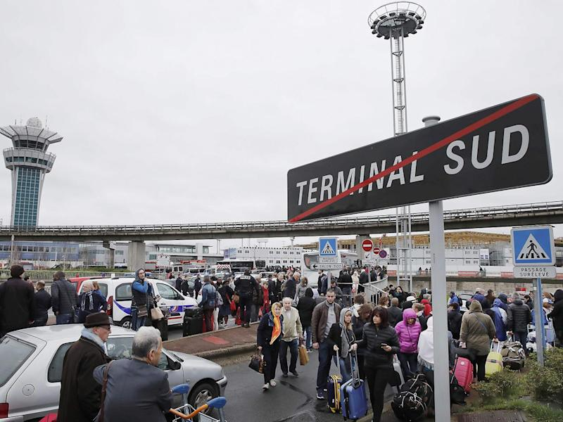 Passengers wait at Orly airport southern terminal after a shooting incident near Paris, France (Reuters)