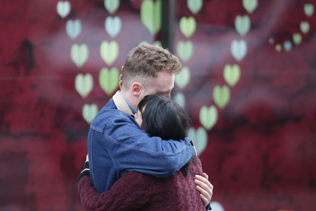 <p>A couple hug at the north end of London Bridge in London, June 4, 2017, after leaving flowers in tribute to the victims of the June 3 terror attack. (Photo: Daneil Leal-Olivas/AFP/Getty Images) </p>
