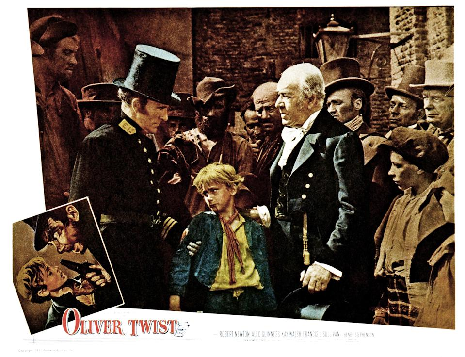 Oliver Twist, lobbycard, from left, Henry Edwards, John Howard Davies, Henry Stephenson, 1948. (Photo by LMPC via Getty Images)