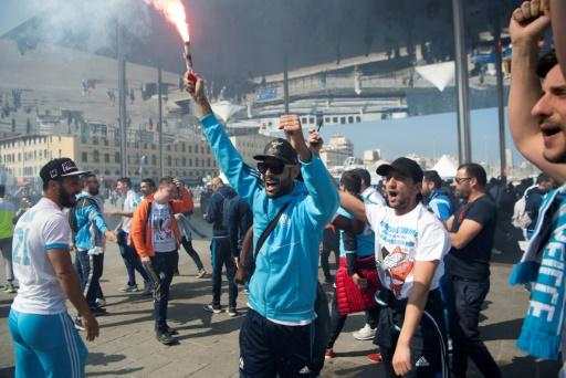 Anticipation is building among Marseille's passionate supporters, including those who have stayed behind to follow the game at home