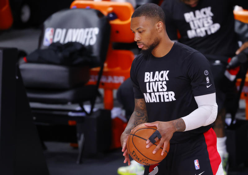 Damian Lillard #0 of the Portland Trail Blazers warms up with tape on his finger.