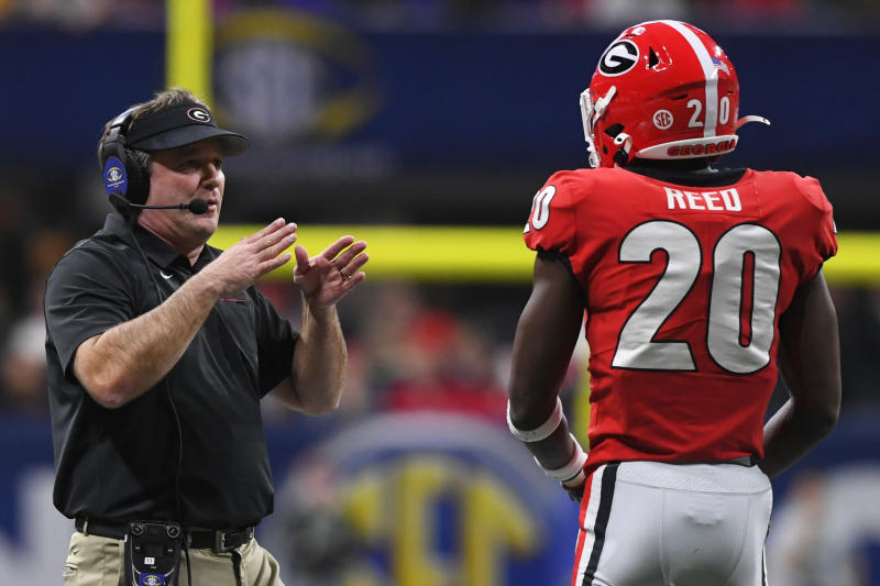 Georgia head coach Kirby Smart speaks to Georgia defensive back J.R. Reed (20) during the first half of the Southeastern Conference championship NCAA college football game against LSU, Saturday, Dec. 7, 2019, in Atlanta. (AP Photo/John Amis)