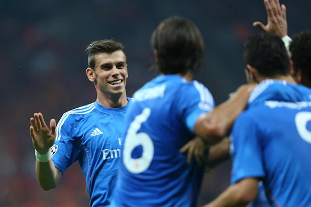 ISTANBUL, TURKEY- SEPTEMBER 17: Gareth Bale of Real Madrid runs to his teammates as he celebrates the goal against Galatasaray during UEFA Champions League Group B match at the Ali Sami Yen Area on September 17, 2013 in Istanbul, Turkey. (Photo by Burak Kara/Getty Images)