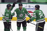 Dallas Stars' Jason Robertson (21) and Roope Hintz (24) celebrate a third-period goal by Joe Pavelski (16) against the Columbus Blue Jackets during an NHL hockey game Thursday, April 15, 2021, in Dallas. (AP Photo/Richard W. Rodriguez)