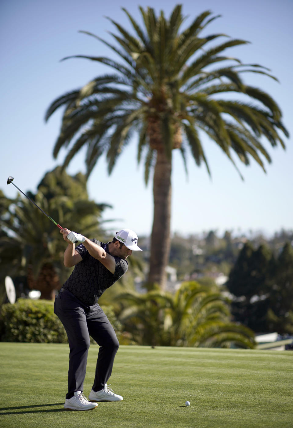 Jon Rahm tees off on the first hole during the third round of the Genesis Invitational golf tournament at Riviera Country Club, Saturday, Feb. 20, 2021, in the Pacific Palisades area of Los Angeles. (AP Photo/Ryan Kang)