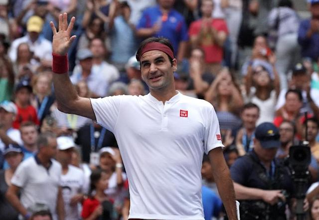Victory smile: Roger Federer celebrates his win against Nick Kyrgios (AFP Photo/TIMOTHY A. CLARY)
