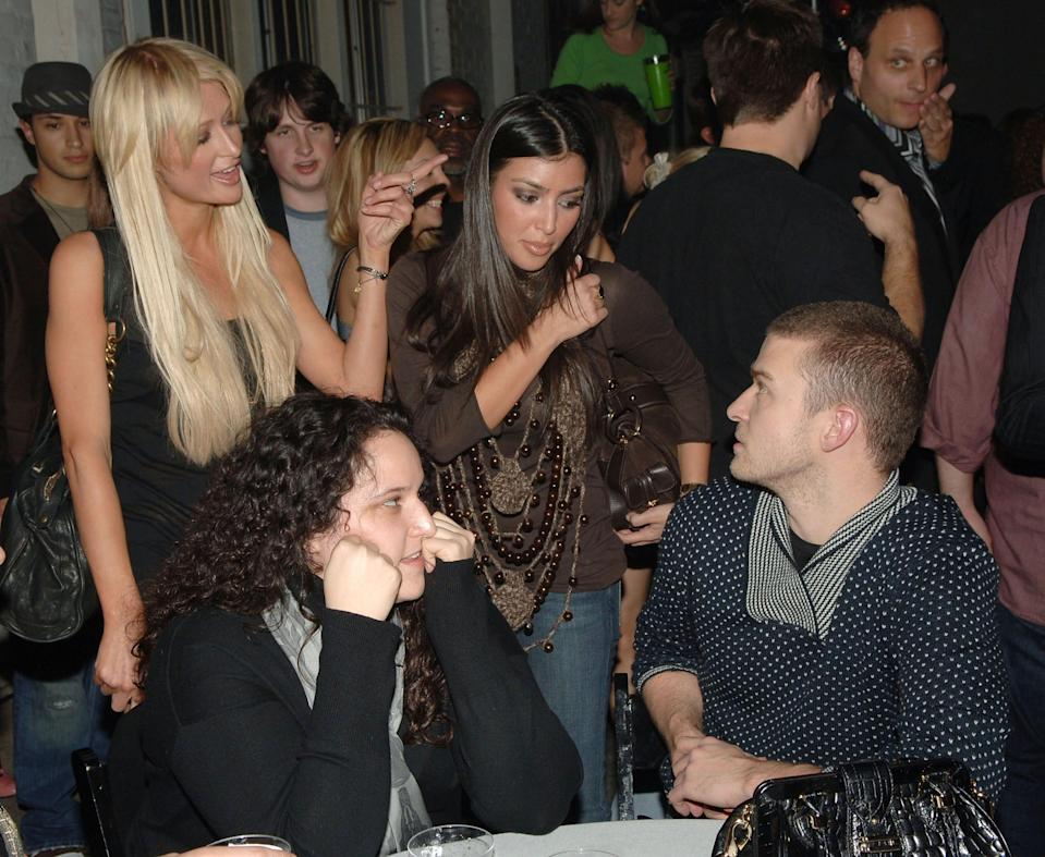 """Kim Kardashian, center, was introduced to the media as a sidekick to Paris Hilton, left. The two conversed with Justin Timberlake, at a party for his film """"Alpha Dog"""" on Jan. 3, 2007 in Hollywood, Calif."""