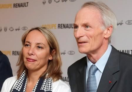 FILE PHOTO: Newly-appointed interim CEO Delbos and Chairman of Renault SA Senard pose before a news conference at French carmaker Renault headquarters in Boulogne-Billancourt