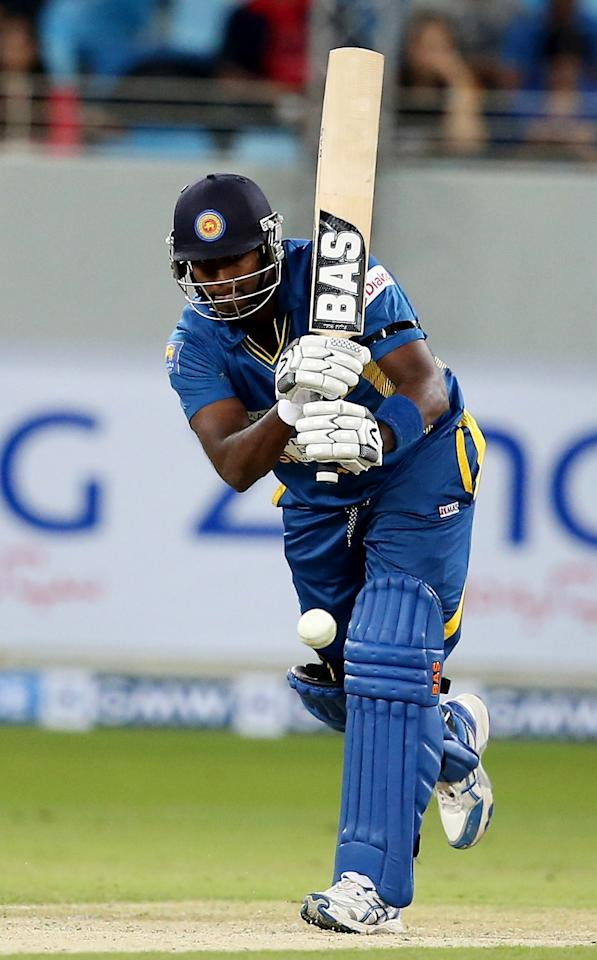 DUBAI, UNITED ARAB EMIRATES - DECEMBER 11:  Angelo Mathews of Srilanka bats during the first Twenty20 International match between Pakistan and Sri Lanka at Dubai Sports City Cricket Stadium on December 11, 2013 in Dubai, United Arab Emirates.  (Photo by Francois Nel/Getty Images)