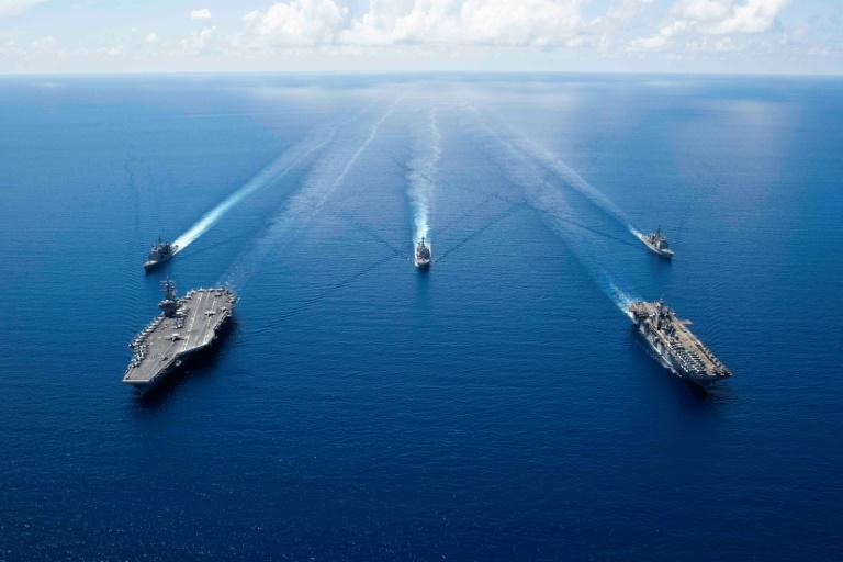 The United States increased its military spending for the third year in a row in 2020, after seven years of reductions (pictured: the USS Ronald Reagan carrier strike group)
