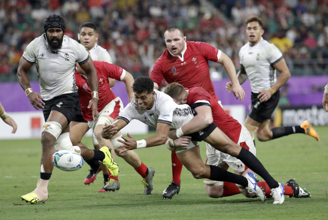 Fiji's Ben Volavola loses the ball in the tackle during the Rugby World Cup Pool D game at Oita Stadium between Wales and Fiji in Oita, Japan, Wednesday, Oct. 9, 2019. (AP Photo/Aaron Favila)