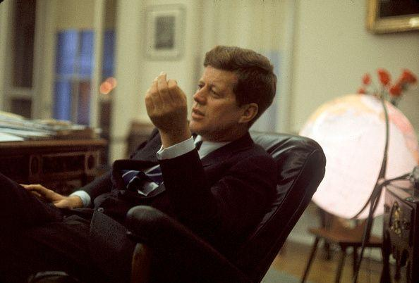 <p>President Kennedy at his desk in the Oval Office. </p>