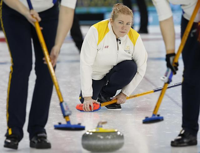 Sweden's skip Margaretha Sigfridsson, watches the rock during the women's curling competition against Switzerland at the 2014 Winter Olympics, Thursday, Feb. 13, 2014, in Sochi, Russia. (AP Photo/Wong Maye-E)
