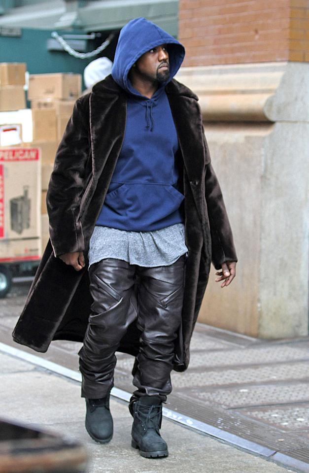 Kanye West makes quite the outfit statement in a chocolate colored velvet coat, black leather pants and black boots, as he makes his way around New York City