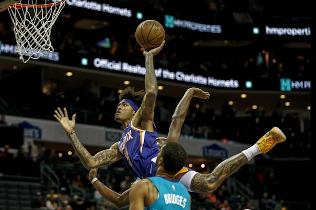 Phoenix Suns forward Kelly Oubre Jr. (3) shoots over Charlotte Hornets forward Miles Bridges in the first half of an NBA basketball game in Charlotte, N.C., Monday, Dec. 2, 2019. (AP Photo/Nell Redmond)