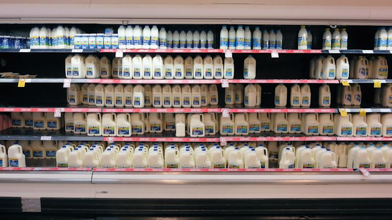 Fridges stocked with milk are seen in a Coles supermarket on May 24, 2016 in Sydney, Australia.